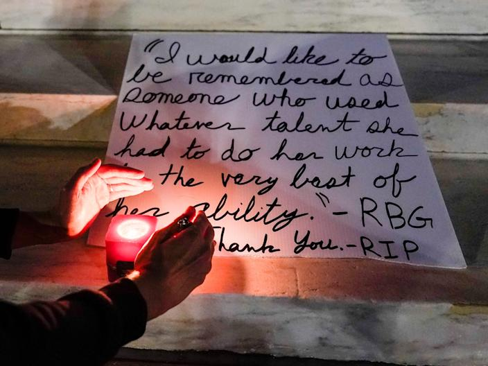 """People light candles outside the Supreme Court Friday, Sept. 18, 2020, in Washington, after the Supreme Court announced that Supreme Court Justice Ruth Bader Ginsburg died of metastatic pancreatic cancer at age 87. <p class=""""copyright"""">Alex Brandon/AP</p>"""
