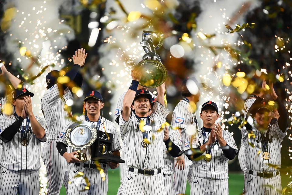 Japan's baseball players celebrate with the trophy their win against South Korea after the WBSC Premier 12 Super Round Final baseball game between South Korea and Japan, at the Tokyo Dome in Tokyo on November 17, 2019. (Photo by CHARLY TRIBALLEAU / AFP) (Photo by CHARLY TRIBALLEAU/AFP via Getty Images)