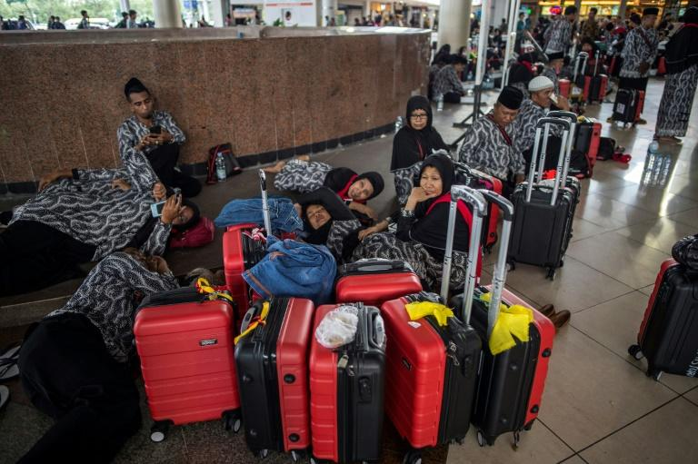In the world's most populous Muslim nation Indonesia, tens of thousands of would-be pilgrims were left in limbo by the Saudi decision to suspend access to the Islamic holy places (AFP Photo/Juni KRISWANTO)