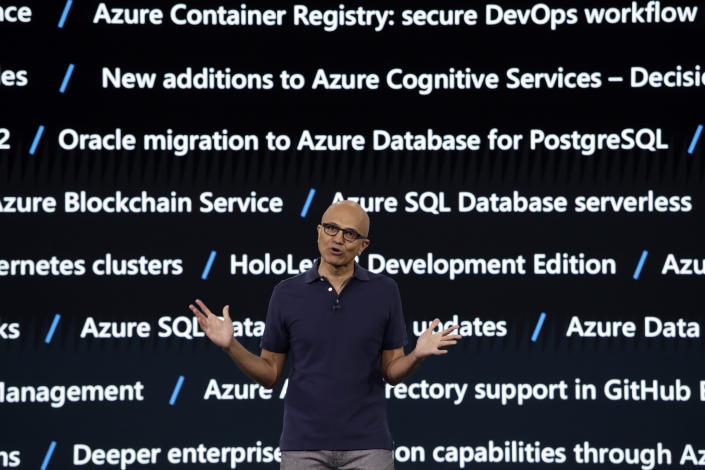 With a screen displaying some of the new Microsoft Azure services and updates in the background, Microsoft CEO Satya Nadella delivers the keynote address at Build, the company's annual conference for software developers Monday, May 6, 2019, in Seattle. (AP Photo/Elaine Thompson)