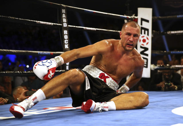 Sergey Kovalev, of Russia, is dazed as he sits in the ring after after a punch by Eleider Alvarez, of Colombia, during the seventh round of their boxing bout at 175 pounds, Saturday, Aug. 4, 2018, in Atlantic City, N.J. Alvarez won by knockout in the seventh round. (AP Photo/Mel Evans)