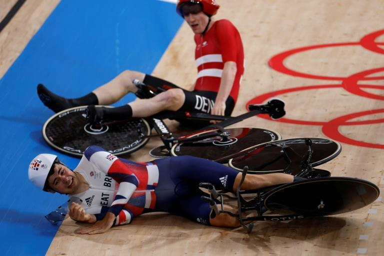 Denmark's Frederik Madsen crashed into Britain's Charlie Tanfield (bottom) during their men's team pursuit race on Tuesday