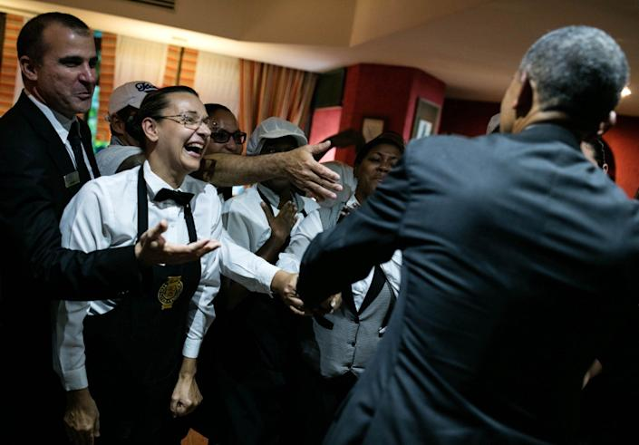 Obama greets hotel workers in Havana.