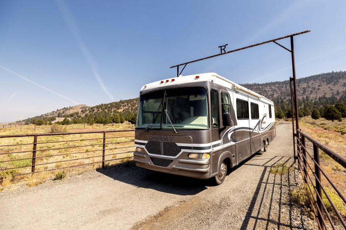 Woody Faircloth drives a donated RV while delivering it to Dixie Fire victim John Hunter, Sunday, Sept. 5, 2021, in Sierra County, Calif. (AP Photo/Noah Berger)