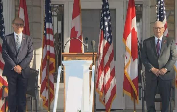 U.S. Chargé d'Affaires Arnold Chacon, left, and Speaker of the Senate of Canada George Furey, right, participate in a ceremony commemorating the 20th anniversary of the Sept. 11 terrorist attacks in Ottawa on Saturday. (Alexander Behne/CBC News - image credit)