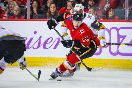 Nov 19, 2018; Calgary, Alberta, CAN; Calgary Flames left wing Matthew Tkachuk (19) controls the puck against the Vegas Golden Knights during the third period at Scotiabank Saddledome. Calgary Flames won 7-2. Mandatory Credit: Sergei Belski-USA TODAY Sports