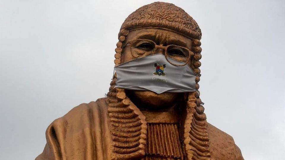 Even statues are wearing masks as seen here in Nigeria's commercial capital, Lagos, on Monday.