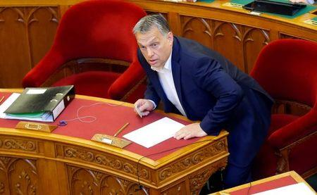 Hungarian Prime Minister Orban arrives to a vote on a bill tightening regulations on foreign universities operating in Hungary, effectively pushing out of the country Central European University