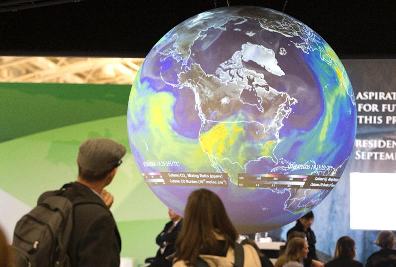 The planned accord would seek to revolutionise the world's energy system by cutting back or potentially eliminating the burning of coal, oil and gas, which leads to the release of Earth-warming greenhouse gases (AFP Photo/Miguel Medina)