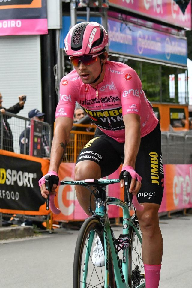 Slovenia's Primoz Roglic pedals past the finish line after completing the 4th stage of the Giro d'Italia, tour of Italy cycling race, from Orbetello to Frascati, Tuesday, May 14, 2019. Richard Carapaz of Ecuador sprinted to victory in the fourth stage of the Giro d'Italia on Tuesday, while Slovenian cyclist Primoz Roglic kept the overall lead after avoiding a crash toward the end of the route. (Alessandro Di Meo/ANSA via AP)