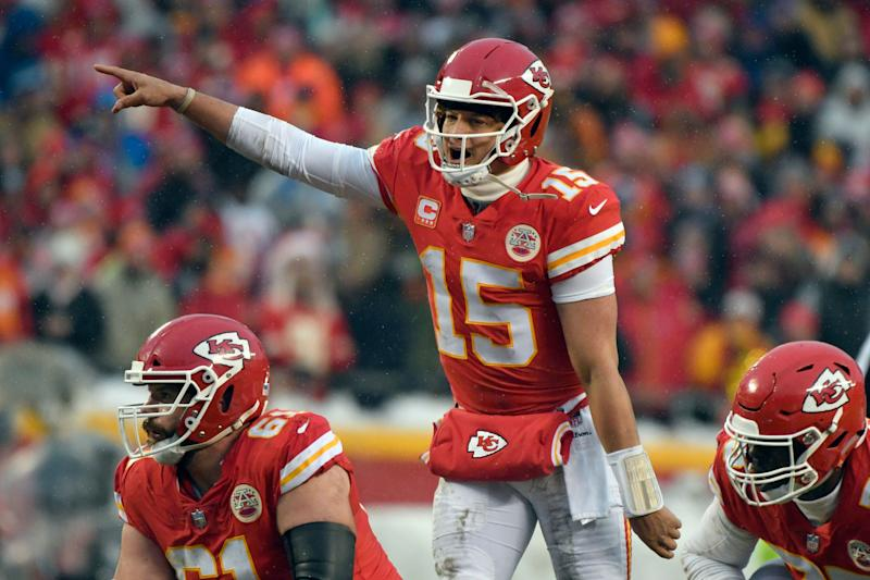 FILE - In this Jan. 12, 2019, file photo, Kansas City Chiefs quarterback Patrick Mahomes (15) calls a play at the line of scrimmage during the first half of the team's NFL divisional football playoff game against the Indianapolis Colts in Kansas City, Mo. The popular, record-setting quarterback shattered just about every franchise passing record in his first season as a starter, and his down-home style has made him a fan-favorite. The Chiefs play the New England Patriots on Sunday for the AFC championship. (AP Photo/Ed Zurga, File)
