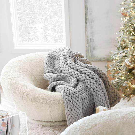 """<p><strong>Pottery Barn Teen</strong></p><p>pbteen.com</p><p><strong>$129.00</strong></p><p><a href=""""https://go.redirectingat.com?id=74968X1596630&url=https%3A%2F%2Fwww.pbteen.com%2Fproducts%2Fsuper-chunky-knit-throw%2F&sref=https%3A%2F%2Fwww.cosmopolitan.com%2Flifestyle%2Fg32613217%2Fbest-throw-blankets%2F"""" rel=""""nofollow noopener"""" target=""""_blank"""" data-ylk=""""slk:Shop Now"""" class=""""link rapid-noclick-resp"""">Shop Now</a></p><p>This one just screams <em>cuddles</em>. I have searched forever for one of these chunky and ~heavenly~ knit throws that does. Not. Shed. And finally, here it is.</p>"""