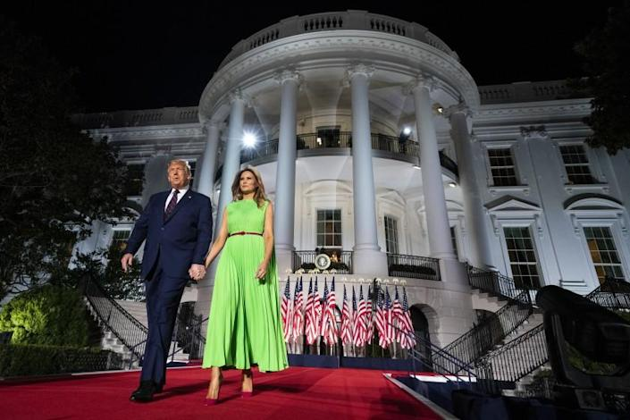 President Donald Trump and first lady Melania Trump arrive on the South Lawn of the White House for the fourth day of the Republican National Convention, Thursday, Aug. 27, 2020, in Washington. (AP Photo/Evan Vucci)