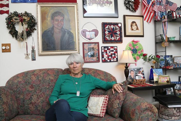 Sally Schindel sits in front of a painting of her son Andrew Zorn, who took his own life after saying he became addicted to marijuana. She talked of his life and the problems marijuana cause for their family at her home in Prescott, Ariz. on April 4, 2017. (Photo: Patrick Breen for Yahoo News)