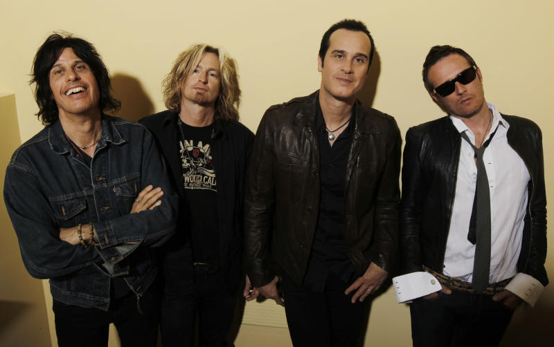 """FILE - This April 30, 2010 file photo shows the Stone Temple Pilots, from left, Dean Deleo, Eric Kretz, Robert Deleo, and Scott Weiland from the band Stone Temple Pilots, pose for a portrait in Santa Monica, Calif. In a one-sentence news release on Wednesday, Feb. 27, 2013, publicist Kymm Britton said: """"Stone Temple Pilots have announced they have officially terminated Scott Weiland."""" No other information was provided. (AP Photo/Matt Sayles, file)"""