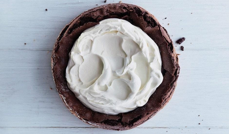 """The late Richard Sax, celebrated cookbook author and champion of home cooks the world over, inspired this flourless chocolate cake—a riff on his iconic chocolate cloud cake. <a href=""""https://www.bonappetit.com/recipe/fallen-chocolate-cake?mbid=synd_yahoo_rss"""">See recipe.</a>"""