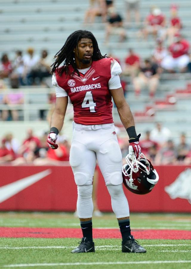 Arkansas wide receiver Keon Hatcher (4) walks on the field before their spring NCAA college football game in Fayetteville, Ark., Saturday, April 26, 2014. (AP Photo/Sarah Bentham)