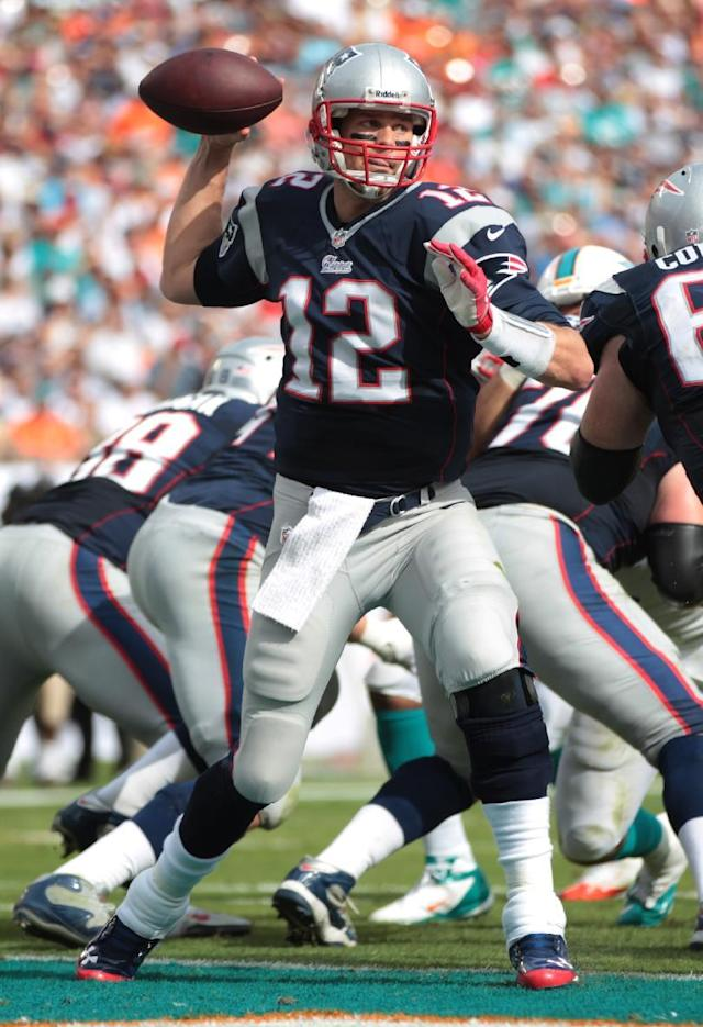 New England Patriots quarterback Tom Brady (12) looks to pass during the first half of an NFL football game against the Miami Dolphins, Sunday, Dec. 15, 2013, in Miami Gardens, Fla. (AP Photo/J Pat Carter)
