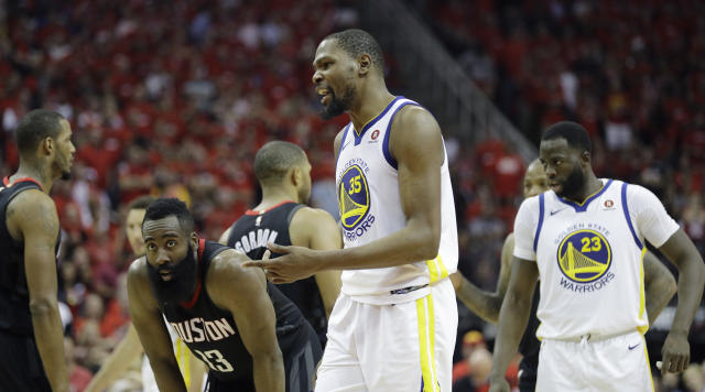 Golden State Warriors forward Kevin Durant (35) reacts to a call during the second half in Game 2 of the NBA basketball Western Conference Finals against the Houston Rockets, Wednesday, May 16, 2018, in Houston. (AP Photo/David J. Phillip)