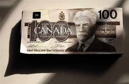 Canadian one hundred dollar bills are displayed in Toronto