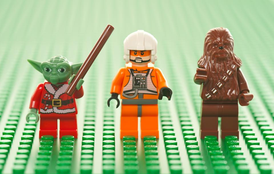 Albuquerque, USA - January 2, 2012: Lego Star Wars figures on green base plate. The Lego toys were originally designed in the 1940s in Denmark and have achieved an international appeal.