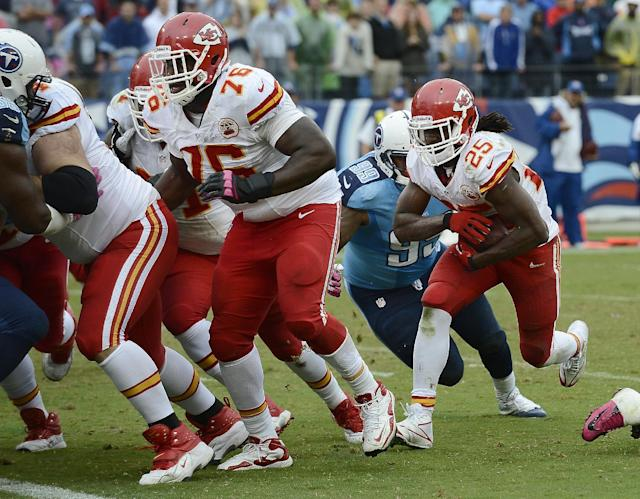 Kansas City Chiefs running back Jamaal Charles (25) follows the block of tackle Branden Albert (76) to score a touchdown against the Tennessee Titans on a 1-yard run in the fourth quarter of an NFL football game on Sunday, Oct. 6, 2013, in Nashville, Tenn. (AP Photo/Mark Zaleski)
