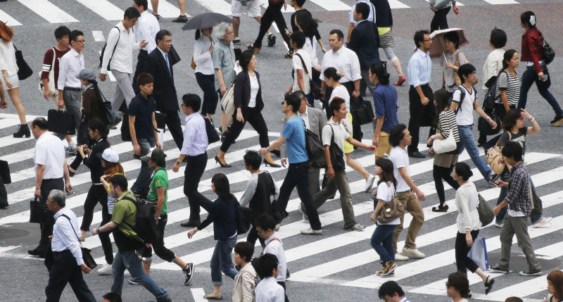"People cross the street in Tokyo Monday, July 1, 2013. The Bank of Japan's closely-watched quarterly ""tankan"" survey for June showed that the index for major manufacturers rose to positive 4 from negative 8 in March. The survey released Monday was the first to be higher than zero since September 2011. A positive reading means more companies are optimistic than pessimistic. (AP Photo/Koji Sasahara)"