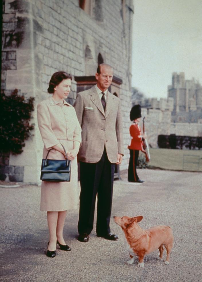 Queen Elizabeth II and Prince Philip with one of their corgis at Windsor Castle in 1959.
