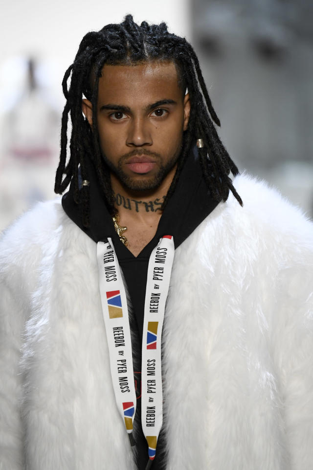 <p>Rapper Vic Mensa's faux locs made a huge statement on the runway. (Photo: Getty Images) </p>