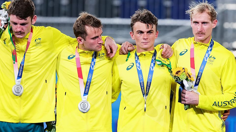 Hockeyroos players, pictured here devastated after taking home silver.