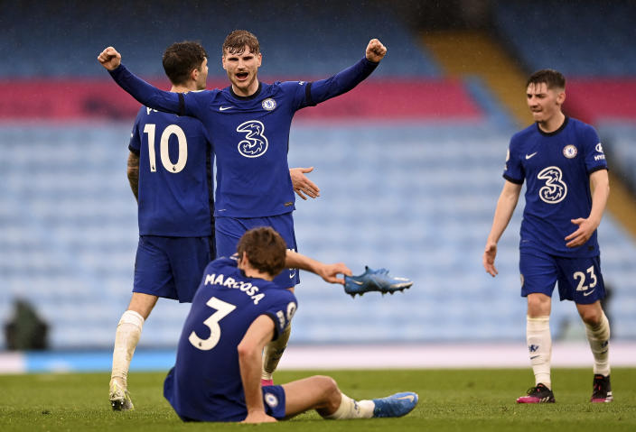 Chelsea's Timo Werner, centre, and Chelsea's Marcos Alonso, front, celebrate after winning the English Premier League soccer match between Manchester City and Chelsea at the Etihad Stadium in Manchester, Saturday, May 8, 2021.(Laurence Griffiths/Pool via AP)