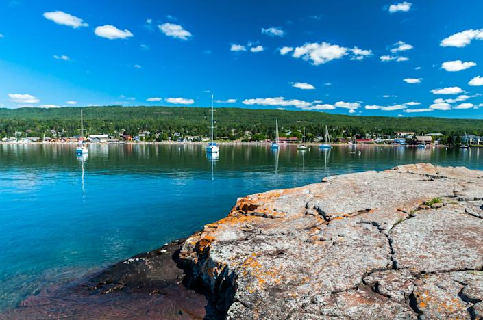 water, greenery and boats in Grand Marais