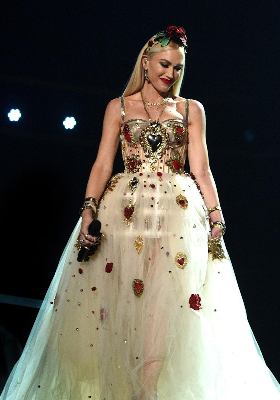<p>Wearing a heart-embellished Dolce &amp; Gabbana gown at the 2020 Grammys.</p>
