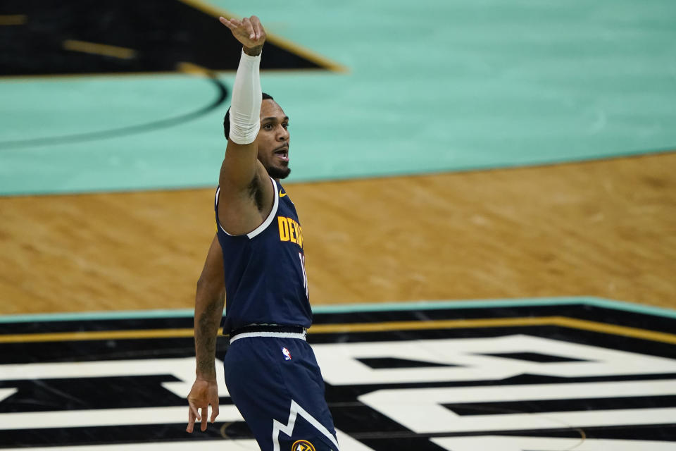 Denver Nuggets guard Monte Morris celebrates after scoring against the Charlotte Hornets during the first half of an NBA basketball game on Tuesday, May 11, 2021, in Charlotte, N.C. (AP Photo/Chris Carlson)