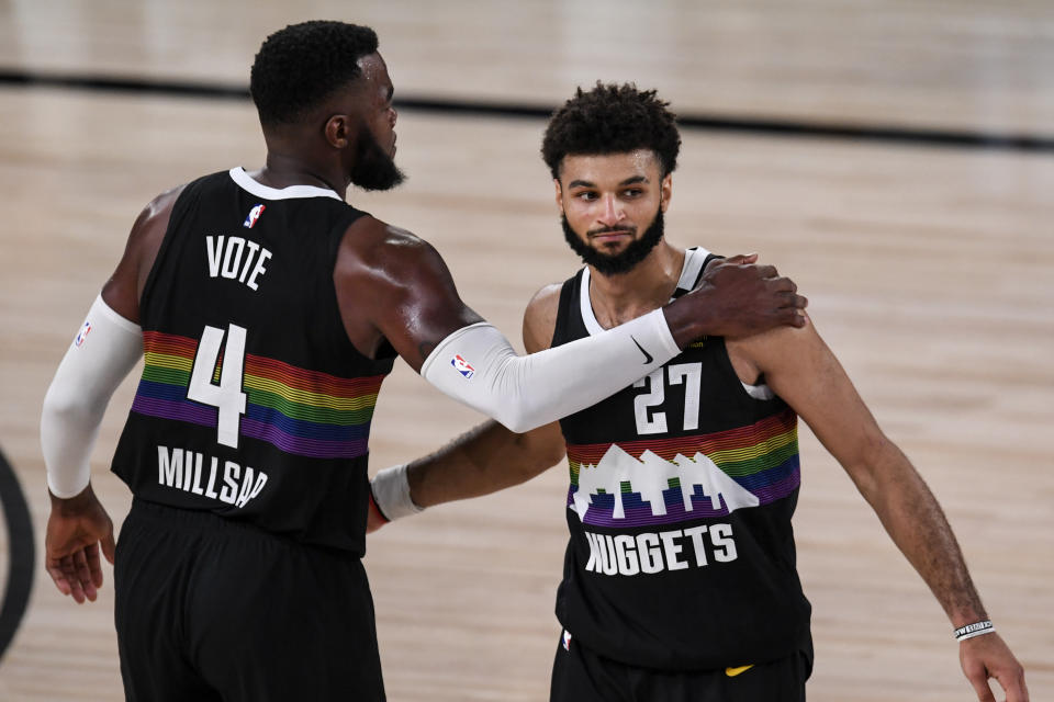 Jamal Murray (27) of the Denver Nuggets and Paul Millsap (4) celebrate a win agains the Los Angeles Lakers