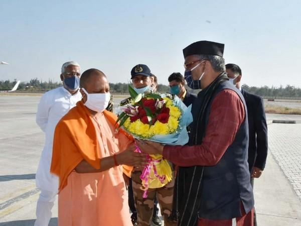Uttarakhand Chief Minister Trivendra Singh Rawat welcomed UP CM Yogi Adityanath at Dehradun airport earlier today. [Photo/ANI]