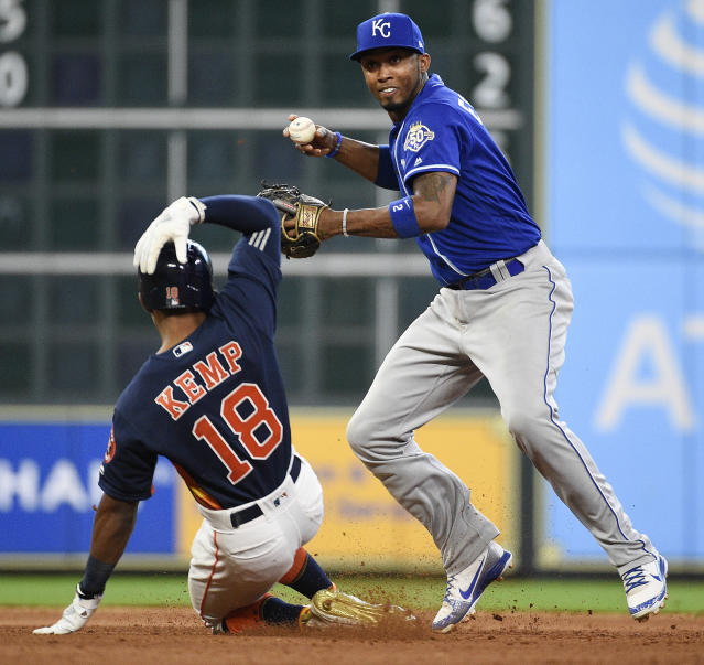 Kansas City Royals shortstop Alcides Escobar, right, turns a double play over Houston Astros' Tony Kemp during the fifth inning of a baseball game, Sunday, June 24, 2018, in Houston. (AP Photo/Eric Christian Smith)