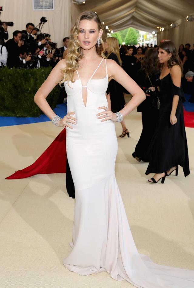<p>The Victoria's Secret model and wife of singer Adam Levine wore a sleek dress from Topshop. (Photo by Neilson Barnard/Getty Images) </p>