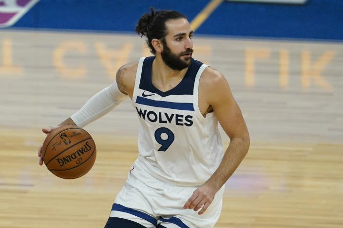 Minnesota Timberwolves guard Ricky Rubio (9) dribbles the ball up the court against the Golden State Warriors during the first half of an NBA basketball game in San Francisco, Monday, Jan. 25, 2021. (AP Photo/Jeff Chiu)