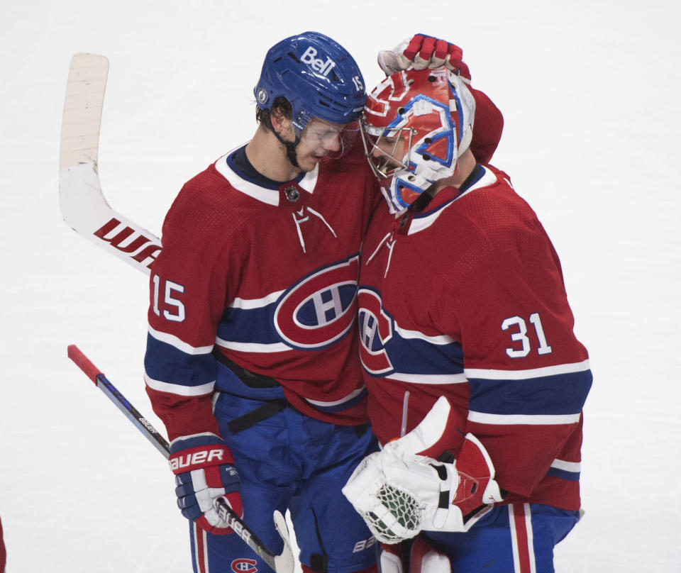 Montreal Canadiens' Jesperi Kotkaniemi (15) celebrates with Carey Price after scoring against the Toronto Maple Leafs during overtime in Game 6 of an NHL hockey Stanley Cup first-round playoff seres Saturday, May 29, 2021, in Montreal. (Graham Hughes/The Canadian Press via AP)