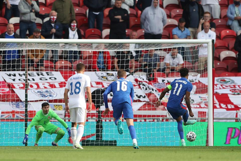 <p>Marcus Rashford slots home from the penalty spot</p> (AP)