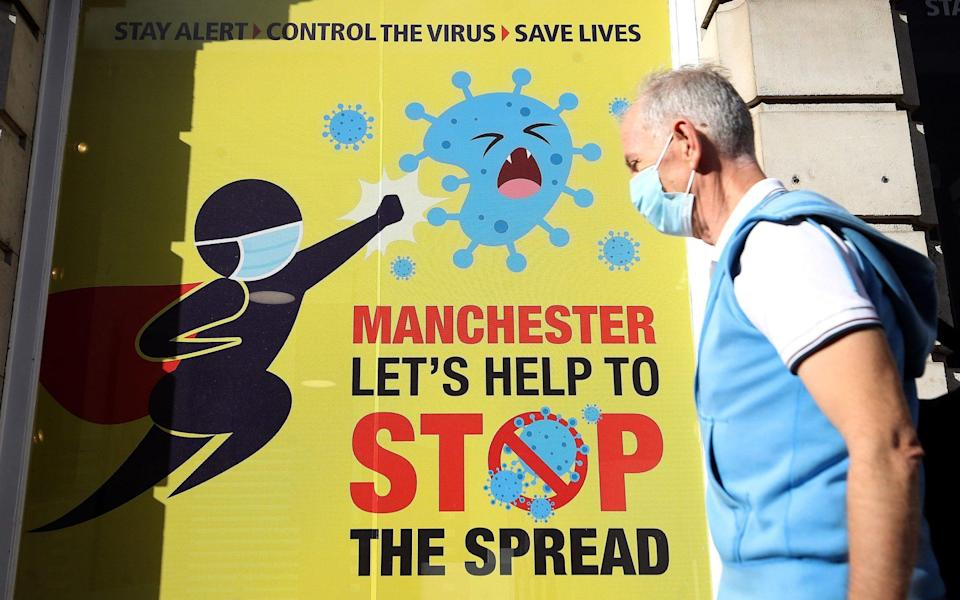 A sign in Manchester urges people to help prevent the spread of Covid-19 - Martin Rickett/PA