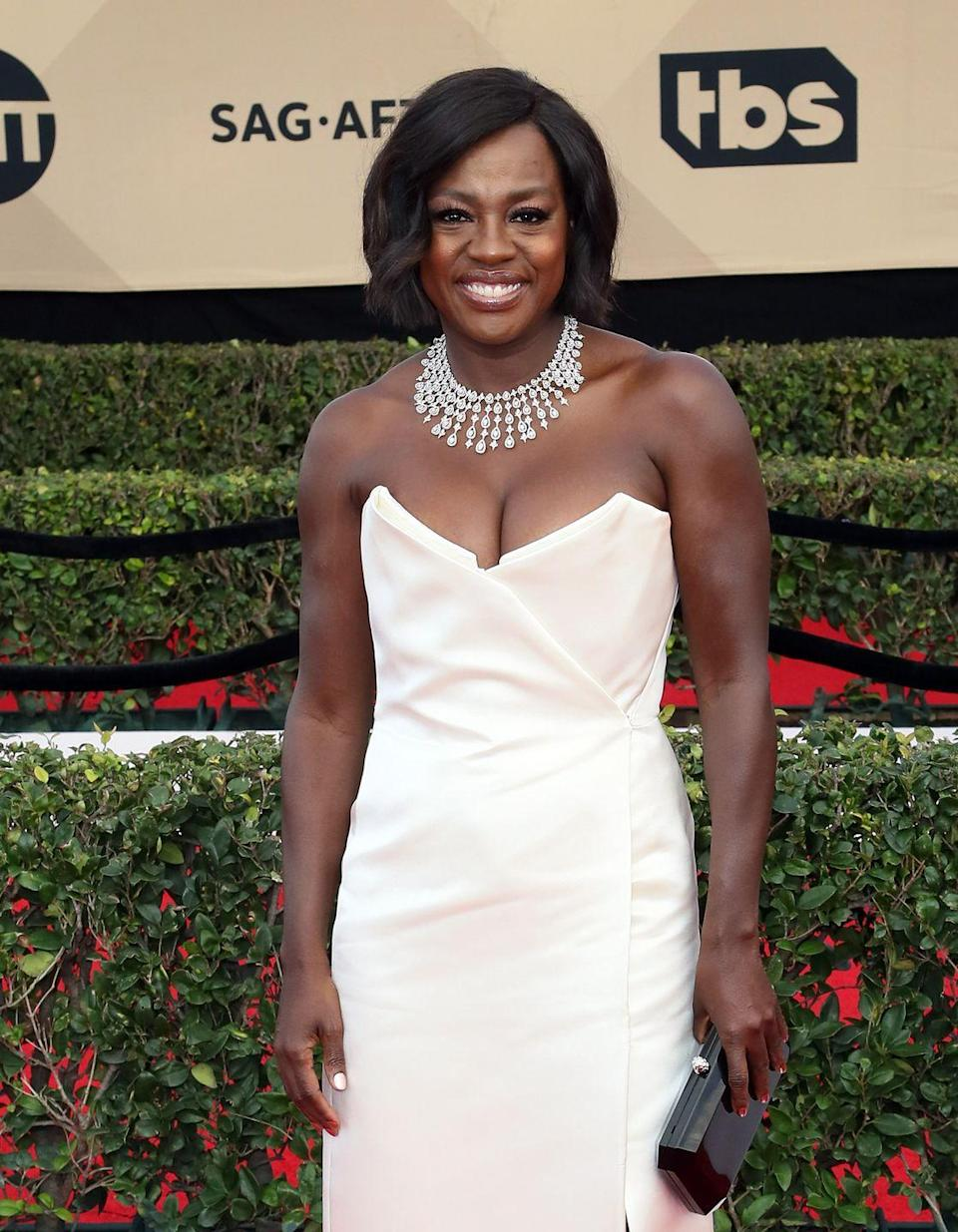 <p>Viola Davis gives her gorgeous smile all the shine with with this chin-length bob and side-swept bangs. Add soft bends to dress up this style. </p>