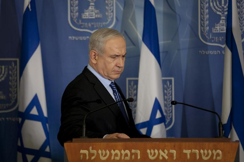 "Israel's Prime Minister Benjamin Netanyahu looks on after delivering a statement to the media at Hakirya a military base in Tel Aviv, Israel, Wednesday, Nov. 14, 2012. Israel's prime minister says the military is prepared to broaden its operation against Hamas targets in Gaza. Benjamin Netanyahu says Israel cannot tolerate continued rocket attacks against its citizens. In his first comments since Israel killed the commander of the Hamas military wing, Netanyahu said Wednesday that Israel is ""prepared to expand the operation"". (AP Photo/Ariel Schalit)"