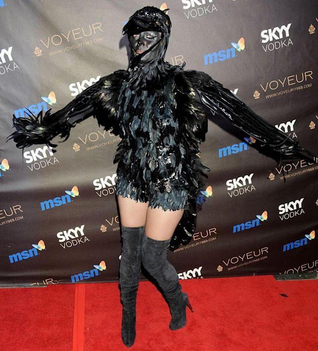 "<p>No. 16: Her costume wasn't much to crow about in 2009. Although a lot of work went into creating the elaborate, feathery getup — which certainly got an ""A"" for effort — ultimately it disguised the <i>Project Runway</i> host too well. She got lost in the crowd, and she shouldn't have at her own party. (Photo: Gregg DeGuire/FilmMagic) </p>"