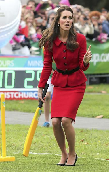 FILE - This is a Monday, April 14, 2014 file photo of Britain's Kate, the Duchess of Cambridge, as sheplays cricket in Latimer Square in Christchurch, New Zealand, Monday, April 14, 2014. Kateís dilemma: What to pack for a two-week trip, when your itinerary includes everything from state receptions and church services to toddler playdates and cricket games? For the Duchess of Cambridge, whoís rounding up her trip to Australia and New Zealand with husband Prince William and 8-month-old son George, there were additional sartorial dilemmas: Do royals take off their shoes at the beach? And whatís the most ladylike way to climb into a fighter jet while in a pencil dress and high heels? (AP Photo/Martin Hunter, Pool, FILE)