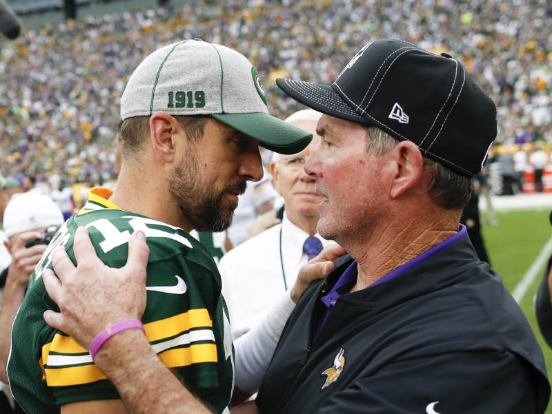Minnesota Vikings head coach Mike Zimmer talks to Green Bay Packers' Aaron Rodgers after an NFL football game Sunday, Sept. 15, 2019, in Green Bay, Wis. The Packers won 21-16. (AP Photo/Matt Ludtke)