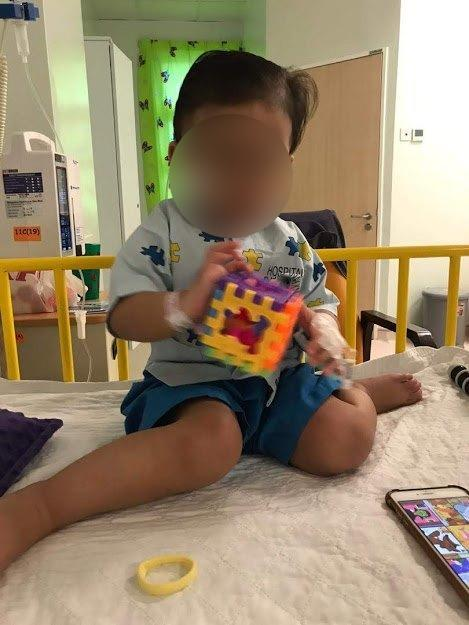 Ira plays with toys at a follow-up appointment, about three weeks after being treated with cannabis oil. Photo: Pokleh