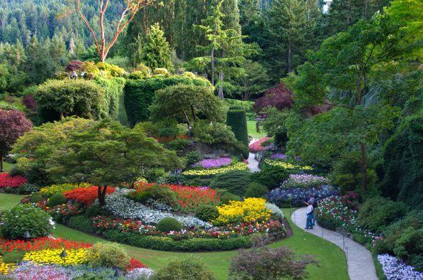 "<p>Once the site of a cement quarry, Robert Pim and Jenni Butchart transformed the old limestone deposits into the beginning of the garden's most well-known attraction the Sunken Garden in 1904. Today, <a href=""https://www.butchartgardens.com/"" rel=""nofollow noopener"" target=""_blank"" data-ylk=""slk:Butchart Gardens"" class=""link rapid-noclick-resp"">Butchart Gardens</a> stretch over 55 acres with 900 bedding plant varieties including a Mediterranean garden and 26 greenhouses. With nearly a million visitors each year, the gardens have been designated as a National Historic Site of Canada.</p>"