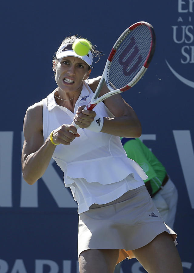Andrea Petkovic, from Germany, returns the ball to Venus Williams during the second set of their match in the Bank of the West Classic tennis tournament in Stanford, Calif., Friday, Aug. 1, 2014. Petkovic won 6-1, 3-6, 7-5. (AP Photo/Jeff Chiu)